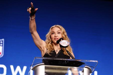 Recording artist Madonna reacts to a question during a news conference for her upcoming Super Bowl XLVI NFL football game halftime show in Indianapolis, Indiana February 2, 2012.   REUTERS/Joe Skipper