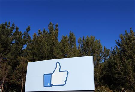 A giant ''like'' icon made popular by Facebook is seen at the company's new headquarters in Menlo Park, California, in this January 11, 2012 file picture. REUTERS/Robert Galbraith/Files