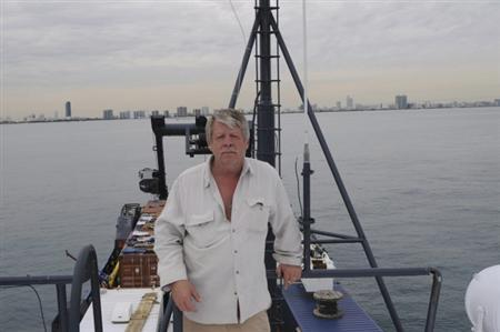 Greg Brooks, co-manager of Sub Sea Research, is pictured standing aboard the Sea Hunter in Miami in this February 2010 file photo obtained by Reuters February 2, 2012. REUTERS/Gary Esper/Handout