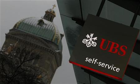 A UBS logo is pictured on a UBS bank building in front of the Swiss federal parliament building in Bern February 1, 2012 REUTERS/Pascal Lauener