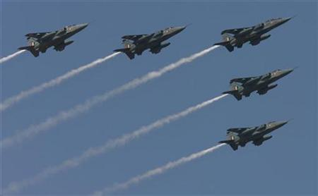 Indian air force Jaguar aircraft fly during the inauguration ceremony of the ''Aero India 2009'' at Yelahanka air force station on the outskirts of the southern Indian city of Bangalore February 11, 2009. REUTERS/Vijay Mathur/Files