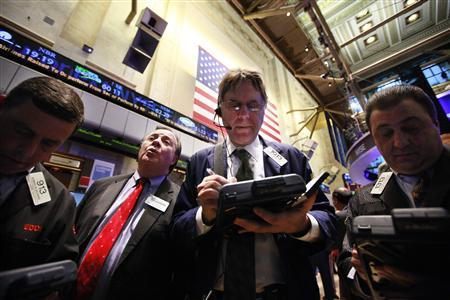 Traders gather at a post on the floor of the New York Stock Exchange, February 3, 2012. REUTERS/Brendan McDermid