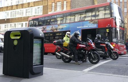 A newly designed bomb-proof rubbish bin is seen on a roadside in the City of London February 2, 2012. REUTERS/Stringer