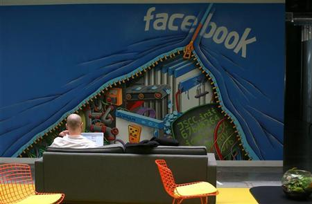 An employee works on a computer at the new headquarters of Facebook in Menlo Park, California, January 11, 2012. REUTERS/Robert Galbraith