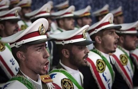 Iranian soldiers sing national anthems during the anniversary ceremony of Iran's Islamic Revolution at the Khomeini shrine in the Behesht Zahra cemetery, south of Tehran, February 1, 2012. REUTERS/Raheb Homavandi