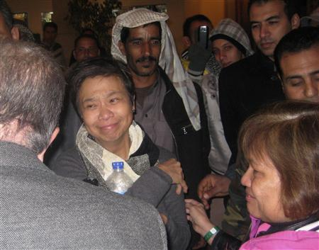One of the two American tourists who were kidnapped is seen with Egyptian officials after her release in a hotel in Saint Catherine, south of Sinai February 3, 2012. Gunmen in Egypt's Sinai Peninsula kidnapped two American women on Friday in an apparent attempt to hold them for ransom, security sources said. Security in the isolated desert region has deteriorated since the overthrow of President Hosni Mubarak in a popular uprising last February. REUTERS/Stringer