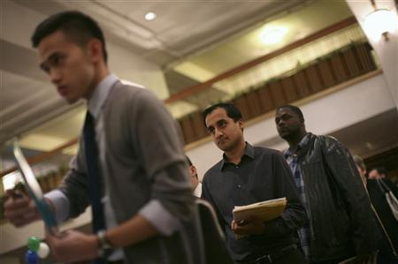 Job seekers stand in line to speak with an employer at a job fair in San Francisco, November 9, 2011. REUTERS/Robert Galbraith
