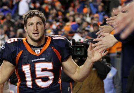 Denver Broncos quarterback Tim Tebow celebrates with fans after the Broncos defeated the Pittsburgh Steelers in overtime in the NFL AFC wildcard playoff football game in Denver, Colorado, January 8, 2012. REUTERS/Marc Piscotty