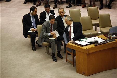 Syrian Ambassador to the United Nations Bashar Jaafari passes a piece of paper during the U.N. Security Council meeting to discuss a European-Arab draft resolution endorsing an Arab League plan calling for Syrian President Bashar al-Assad to give up power in New York February 4, 2012. Russia and China joined forces in a double veto on Saturday to knock down a Western-Arab U.N. Security Council resolution backing an Arab League plan for Syrian President Bashar al-Assad to step aside. REUTERS/Allison Joyce