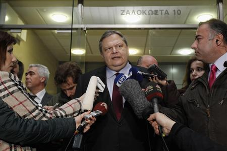 Greece's Finance Minister Evangelos Venizelos makes statements outside his office in Athens February 4, 2012. Greece has agreed with euro zone partners on how to recapitalise Greek banks after a planned bond swap, but has yet to resolve issues related to labour reform and spending cuts in talks with lenders, the country's finance minister said on Saturday.REUTERS/Yiorgos Karahalis