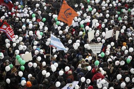 Protesters march during a demonstration for fair elections in central Moscow February 4, 2012.REUTERS/Ivan Gushchin
