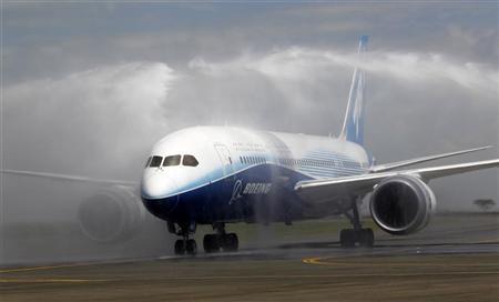 The Boeing Dreamliner 787-800 is hosed down after making its first landing at the Jomo Kenyatta airport in Kenya's capital Nairobi, December 14, 2011. REUTERS/Thomas Mukoya