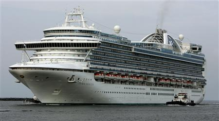 The cruise ship Crown Princess travels into Port Canaveral, Florida in this July 18, 2006 file photo. The ship, operated by Carnival Corp was affected last week by the same virus that has caused 90 passengers and 13 crew members to be contacted with Norovirus on a second ship, Ruby Princess, according to cruise lines spokeswoman Julie Benson February 5, 2012.  REUTERS/Joe Skipper/Files