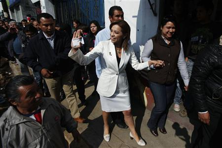 Josefina Vazquez Mota (C), presidential hopeful from Mexico's ruling conservative National Action Party (PAN), greets supporters after casting her ballot during the primary election to choose the party's presidential candidate in Mexico city February 5, 2012. The winner of the primary race will face leftist candidate Andres Manuel Lopez Obrador and former governor Enrique Pena Nieto from the Institutional Revolutionary Party (PRI), who is leading in polls ahead of the July 1 general election. REUTERS/Edgard Garrido