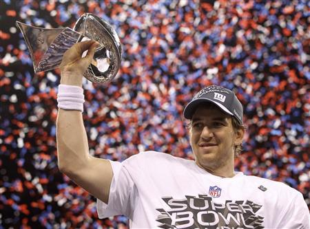 New York Giants quarterback Eli Manning holds the Vince Lombardi Trophy after defeating the New England Patriots  in the NFL Super Bowl XLVI football game in Indianapolis, Indiana, February 5, 2012. REUTERS/Jeff Haynes