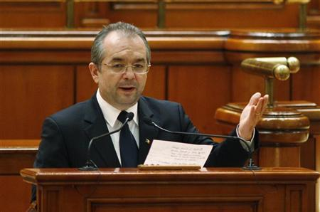 Romania's Prime Minister Emil Boc addresses the Parliament in Bucharest January 23, 2012. REUTERS/Bogdan Cristel