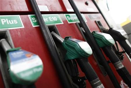 Petrol pump nozzles are pictured at a petrol station in Frankfurt, February 23, 2011. REUTERS/Alex Domanski/Files