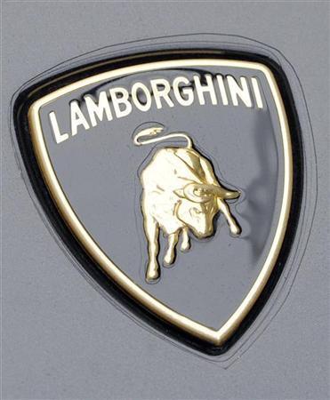 A Lamborghini logo is seen in the showroom in downtown Milan, November 5, 2010. REUTERS/Paolo Bona