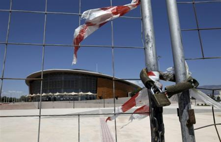 The Olympic Taekwondo stadium is seen behind a fence at Faliro complex in Athens, in this file picture taken May 17 2011. REUTERS/John Kolesidis/Files