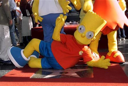 Animated character Bart Simpson reclines on The Simpsons' Hollywood Walk of Fame star after it was unveiled Janaury 14, 2000 during ceremonies along Hollywood Boulevard. Reuters/Rose Prouser