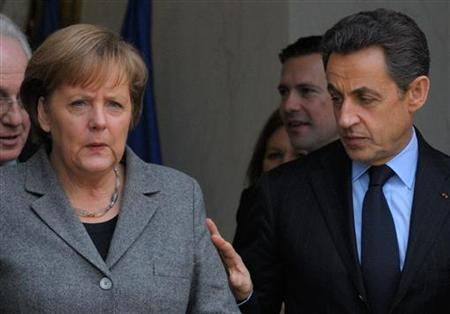 France's President Nicolas Sarkozy (R) accompanies German Chancellor Angela Merkel as she leaves the Elysee Palace in Paris, February 6, 2012 following a Franco-German intergovernmental meeting. REUTERS/Philippe Wojazer
