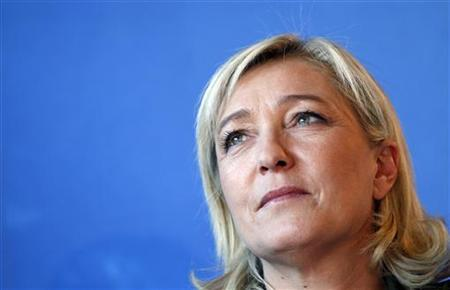 Marine Le Pen, France's National Front head and candidate for 2012 French presidential election, attends a news conference to present her supporting committee for the presidential campaign in Paris February 2, 2012. REUTERS/Regis Duvignau