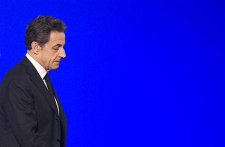 France's President Nicolas Sarkozy arrives to deliver a speech to mark the Chinese and Vietnamese lunar New Year at the Elysee Palace in Paris February 3, 2012.  REUTERS/Lionel Bonaventure/Pool
