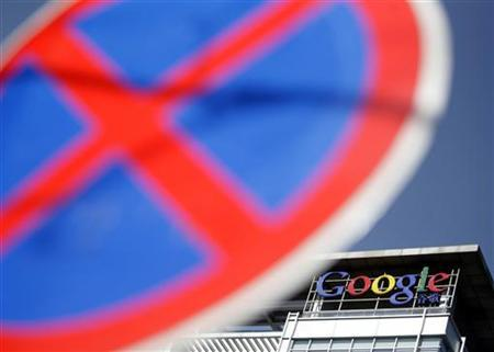 The Google logo is seen on top of Google China headquarters' building in Beijing January 22, 2010. REUTERS/Jason Lee/Files