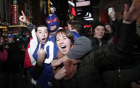 Fans of the New York Giants celebrate their victory over the New England Patriots in Times Square following the Super Bowl XLVI football game in New York February 5, 2012.     REUTERS/Carlo Allegri