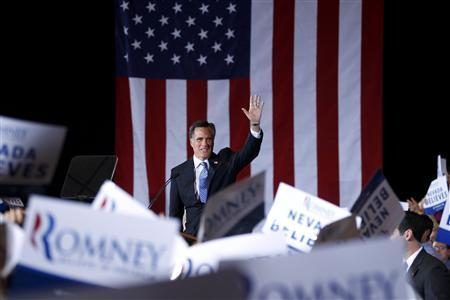 Republican presidential candidate and former Massachusetts Governor Mitt Romney acknowledges supporters at his Nevada caucus night rally in Las Vegas, Nevada, February 4, 2012. REUTERS/Brian Snyder