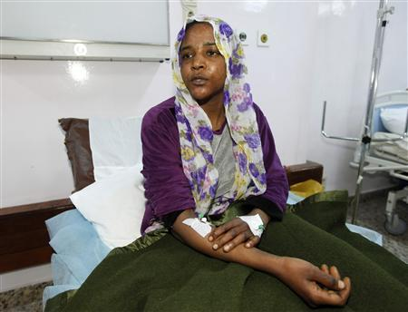 Huda Bel-Eid, a woman from Tawergha who was shot in the leg, sits in Tripoli Hospital in Libya, February 6, 2012.  REUTERS/Ismail Zitouny