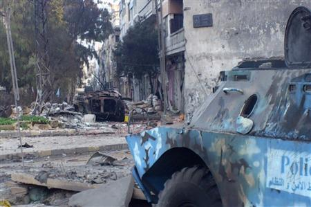 Two damaged armoured military vehicles are seen after clashes between President Bashar al-Assad forces and Free Syrian Army (FSA) in Cairo square near Khaldiyeh area in Homs February 4, 2012. Picture taken February 4, 2012. REUTERS/Stringer