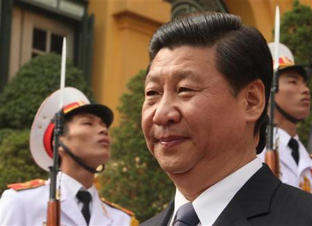 China's Vice President Xi Jinping (front) walks past Vietnamese soldiers while leaving the Presidential Palace in Hanoi December 21, 2011. REUTERS/Stringer