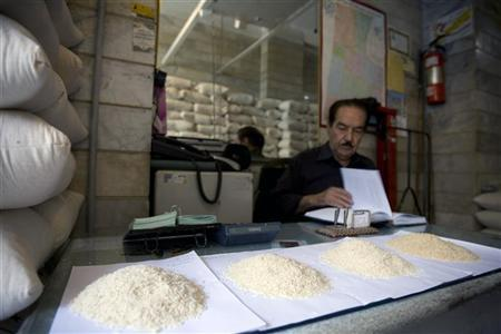 In this file picture, samples of rice are seen on the desk as a rice wholesaler checks his books while waiting for customers at his shop in south Tehran June 18, 2008.   REUTERS/Caren Firouz