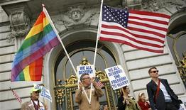 <p>Billy Bradford waves flags outside City Hall after a judge lifted the Proposition 8 stay on same sex marriages at City Hall in San Francisco, California August 12, 2010. REUTERS/Robert Galbraith</p>