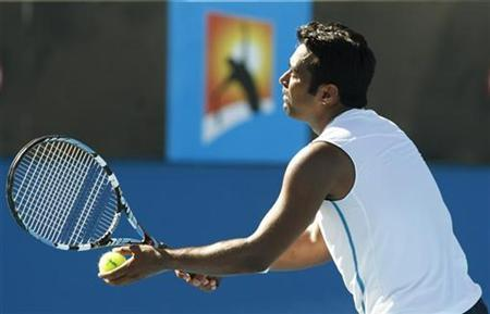 India's Leander Paes serves during his mixed doubles match with Zimbabwe's Cara Black against South Africa's Wesley Moodie and Switzerland's Patty Schnyder at the Australian Open tennis tournament in Melbourne January 27, 2009/Files