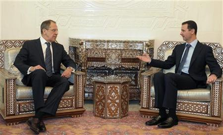 Syrian President Bashar al-Assad (R) speaks with with Russian Foreign Minister Sergey Lavrov during their meeting in Damascus February 7, 2012. REUTERS/Pool