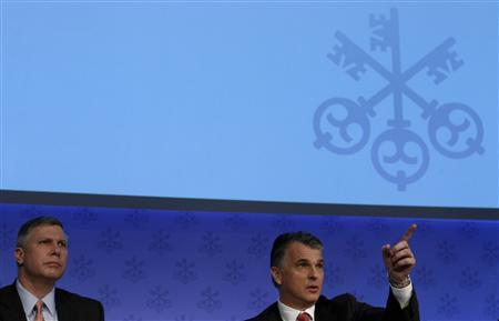 Swiss bank UBS CEO Sergio Ermotti and CFO Tom Naratil (L) address the annual news conference in Zurich February 7, 2012.  REUTERS/Arnd Wiegmann
