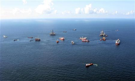 Preparations to drill a relief well continue at the Macondo oil spill site in the Gulf of Mexico, in this aerial photograph taken from a coast guard helicopter on August 21, 2010.  REUTERS/Ann Driver