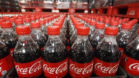 Bottles of Coca-Cola are seen in a warehouse at the Swire Coca-Cola facility in Draper, Utah, March 9, 2011.  REUTERS/George Frey