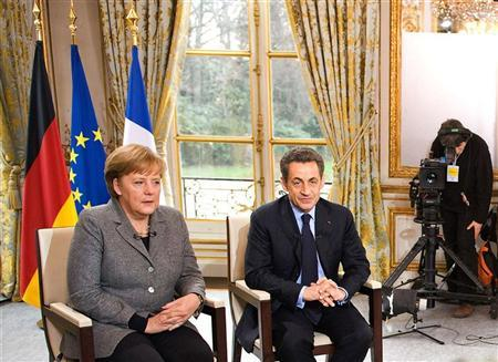 German Chancellor Angela Merkel and French President Nicolas Sarkozy record an television interview with French and German broadcast networks France2 and ZDF at the Elysee palace in Paris February 6, 2012.  REUTERS/Bundesregierung/Jesco Denzel/Pool