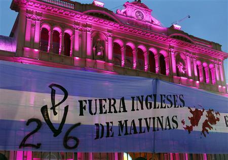 A banner that reads ''Brits get out of the Malvinas (Falkland Islands)'' hang on a fence outside the Government House in Buenos Aires February 7, 2012.  REUTERS/Enrique Marcarian