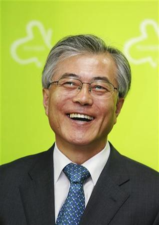 Lawyer and former aide to the late President Roh Moo-hyun, Moon Jae-in, who is also the co-chairman of ''The Liberal Alliance of Renovation and Unity'', smiles as he speaks to the media at his office in Seoul September 27, 2011. REUTERS/Lee Jae-Won/Files