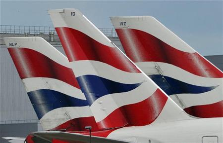 British Airways logos are seen on tailfins at Heathrow Airport in west London May 12, 2011.  REUTERS/Toby Melville