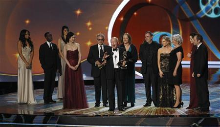 Writer Julian Fellowes accepts the award for outstanding miniseries or movie for ''Downton Abbey,'' at the 63rd Primetime Emmy Awards in Los Angeles September 18, 2011. REUTERS/Mario Anzuoni