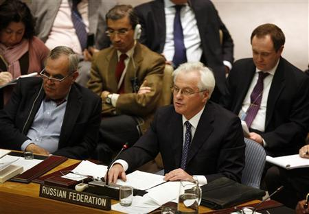 Russian Ambassador to the United Nations Vitaly Churkin speaks with an unidentified delegate during the U.N. Security Council meeting to discuss a European-Arab draft resolution endorsing an Arab League plan calling for Syrian President Bashar al-Assad to give up power in New York February 4, 2012. REUTERS/Allison Joyce