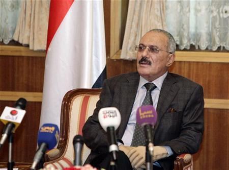 Yemen's outgoing President Ali Abdullah Saleh speaks to a selected group of state media reporters at the Presidential Palace in Sanaa January 22, 2012. REUTERS/Yemen's Presidency/Handout