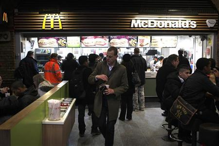 Customers are served at a Mcdonald's fast food restaurant in London, January 24, 2012.  REUTERS/Finbarr O'Reilly