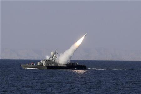 A new medium-range missile is fired from a naval ship during Velayat-90 war game on Sea of Oman near the Strait of Hormuz in southern Iran January 1, 2012. Iran test-fired a new medium-range missile, designed to evade radars, on Sunday during the last days of its naval drill in the Gulf, the official IRNA news agency quoted a military official as saying. REUTERS/Jamejamonline/Ebrahim Norouzi