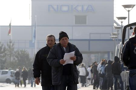 Workers leave after finishing a shift at the Nokia phone assembly plant in Komarom, 85 km (52.8 miles) west of Budapest February 8, 2012. REUTERS/Laszlo Balogh